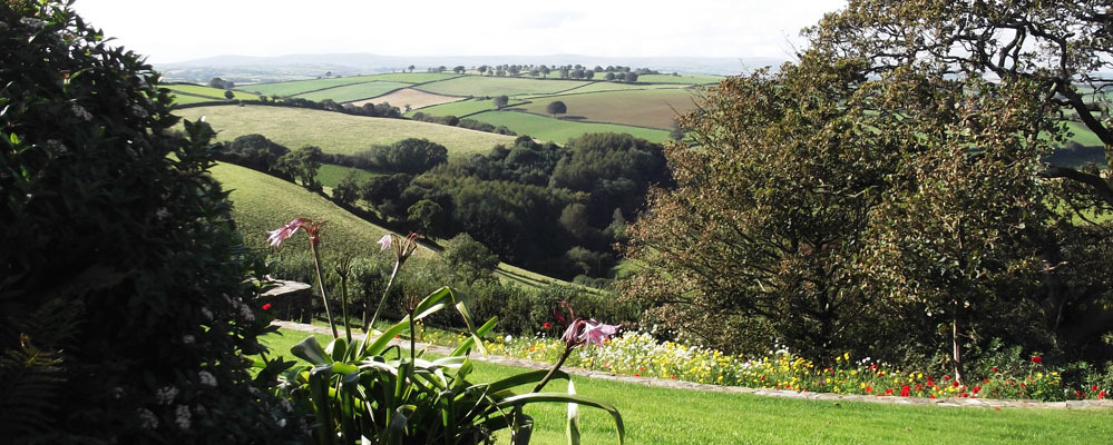 Kerswell Farmhouse B&B is a luxury boutique Bed and Breakfast between Totnes and Dartmouth in the South Hams area of South Devon with extensive views over farmland to Dartmoor and glorious sunsets